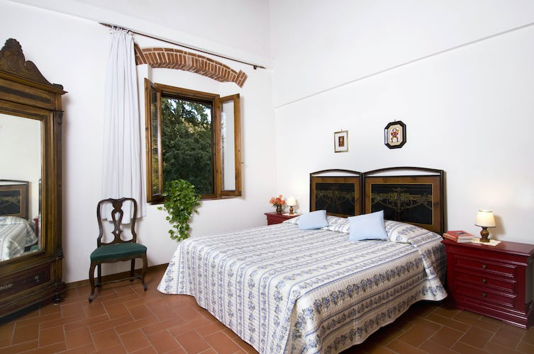 This is the Il Bosco bedroom furnished in rustic Tuscan style