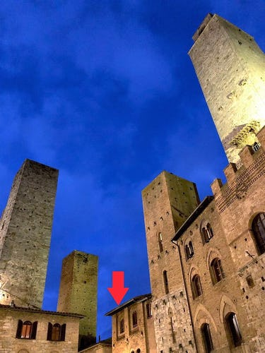 Attico Duomo location in the corner of Piazza del Duomo amidst medieval towers