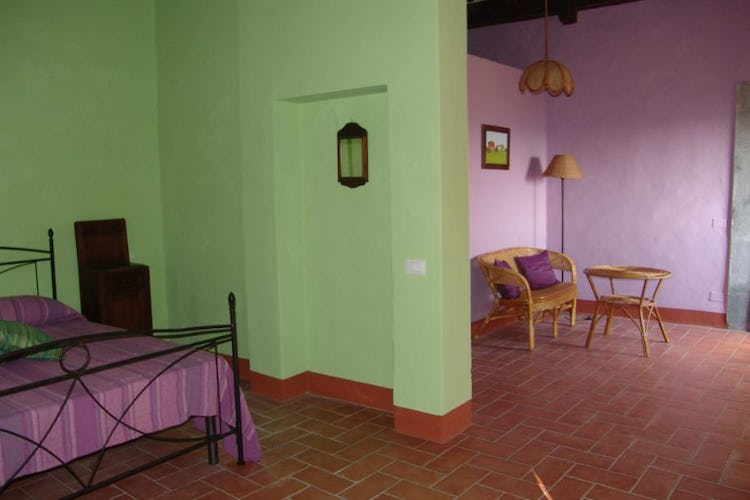 A wide coloured room of the farmhouse
