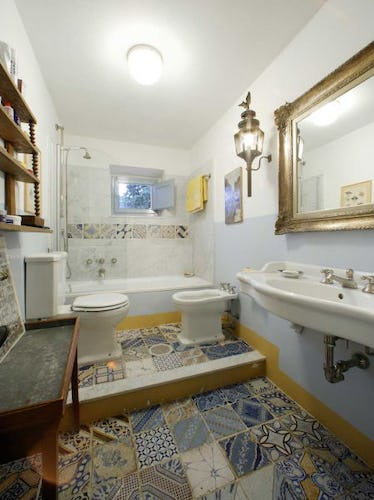 A bathroom with a full sized tub at Candida's Chianti House