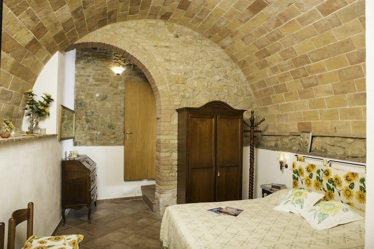 Agriturismo Casa dei Girasoli - Gli archi con la pietra a vista, tipici delle costruzioni rurali toscane