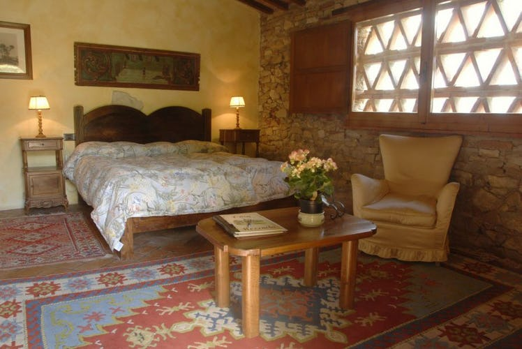 Restored stone walls accent the country loot at Casa Mezzuola