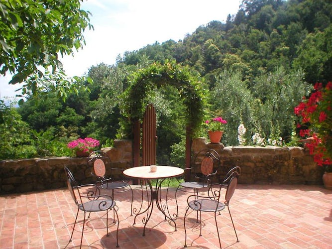 The gorgeous panoramic terrace provided with table and chairs