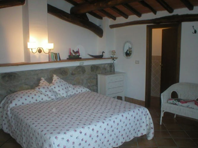 Rustic and stylish double bedroom of Casale Bozzo