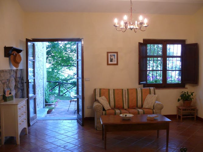Living room fully equipped and furnished in typical Tuscan style