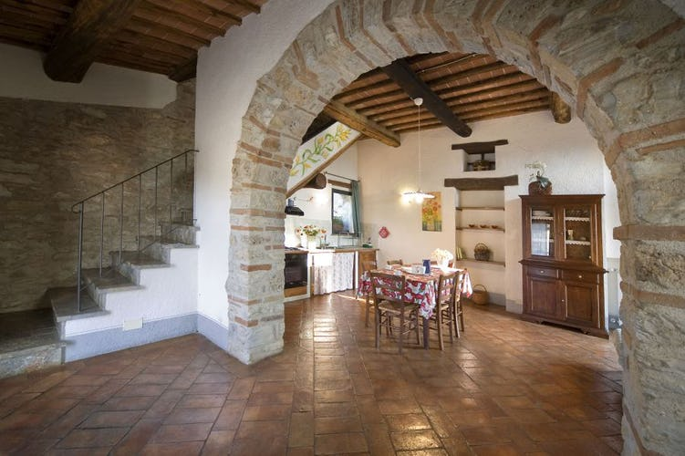 Terracotta floors & woodbeam ceilings are typical at Podere Ripostena