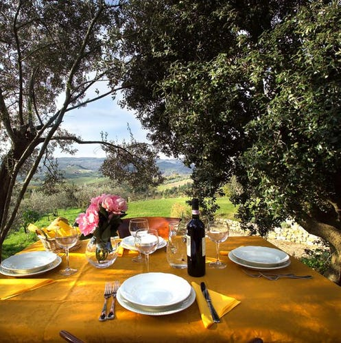 Enjoy meals in the private garden at Chianti Apartments
