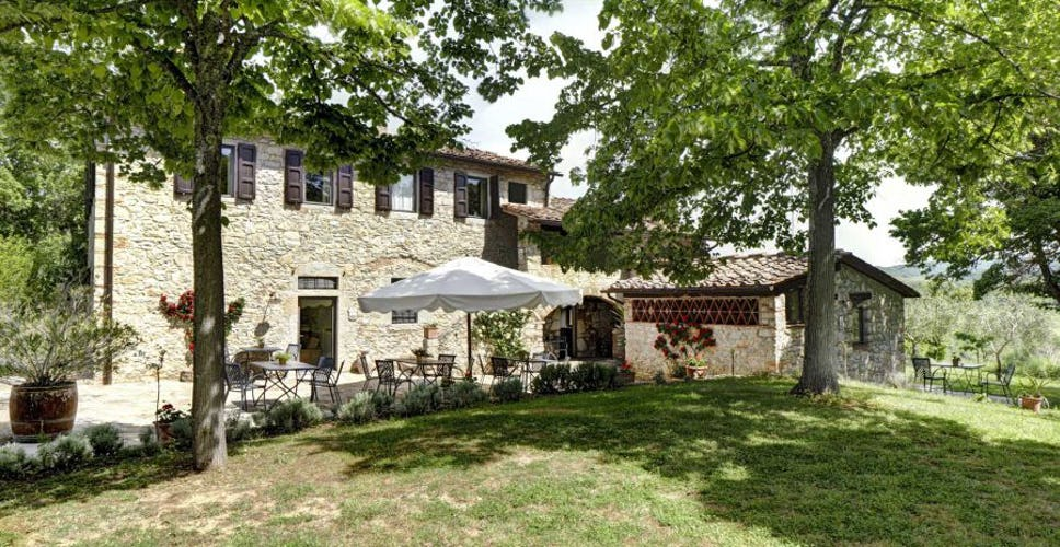 Traditional Tuscan farmhouses surrounded by shady gardens & patios