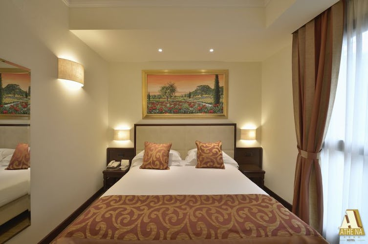 Large double beds in the newly refurnished rooms at Hotel Athena
