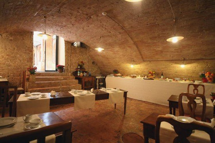 The antique cellar with the breakfast buffet  at il Chiostro del Carmi