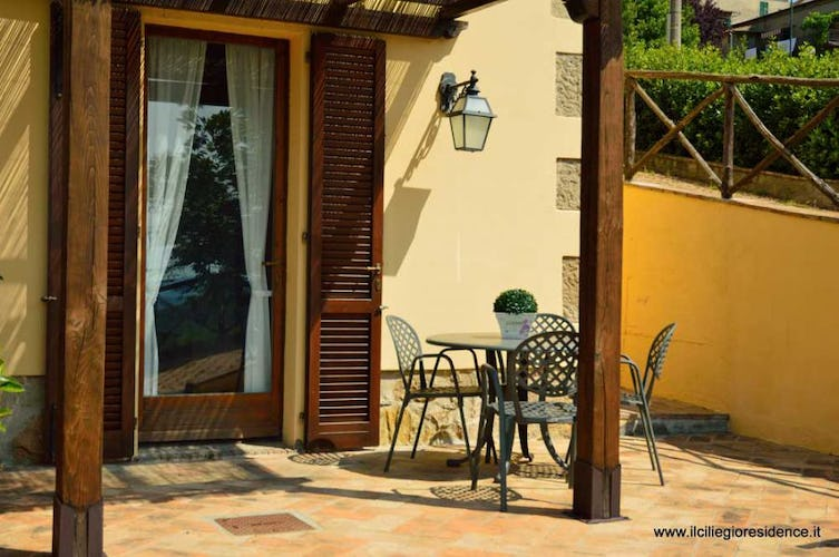 Enjoy meals outside in the fresh air at Il Ciliegio Residence