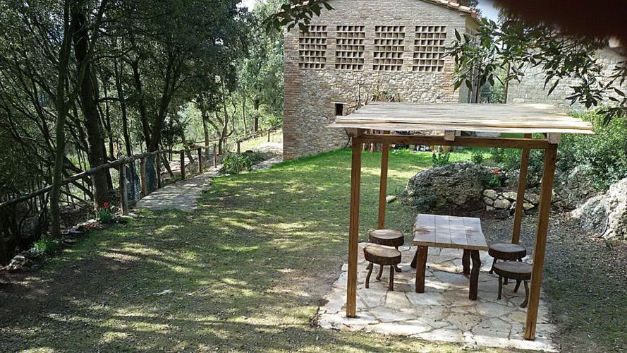 Private garden area with shaded picnic zone and BBQ