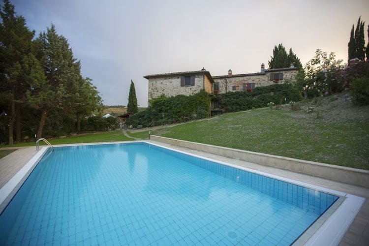 One of the outdoor pool in front of the stone house