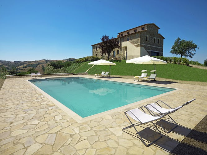 Poderi Firenze - Poolside View of Farmhouse