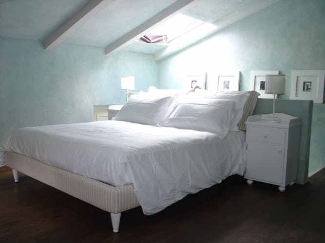 The cozy bed of the blue suite