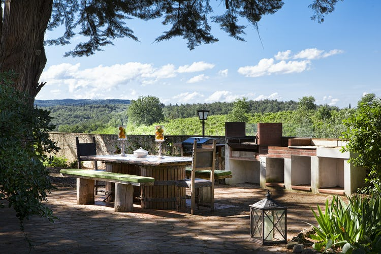 Picnic tables and BBQ grill invite you to eat outdoors