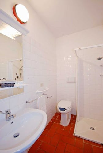 Clean and spacious bathrooms with showers for all bedrooms